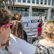 WASHINGTON,DC-JUL13: Stories of sexual assault on college campuses are read aloud by volunteers at a rally for survivors and their allies, outside the Department of Education, ahead of a series of meetings that Secretary Betsy DeVos is holding with survivors, advocates for the wrongly accused and college administrators. DeVos is considering whether to rollback Obama-era guidance on handling sexual assault, which victims' advocates credit with improving the situation on college campuses, and which others say has led schools to err on the side of finding students guilty of assault even when they are innocent. (Photo by Evelyn Hockstein/For The Washington Post)