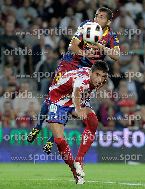 22.09.2010, Camp Nou, Madrid, ESP, Primera Division, FC Barcelona vs Sporting Gijon, im Bild FC Barcelona's Daniel Alves (t) and Sporting de Gijon's Jose Angel during La Liga match. EXPA Pictures © 2010, PhotoCredit: EXPA/ Alterphotos/ Acero +++++ ATTENTION - OUT OF SPAIN / ESP +++++ / SPORTIDA PHOTO AGENCY