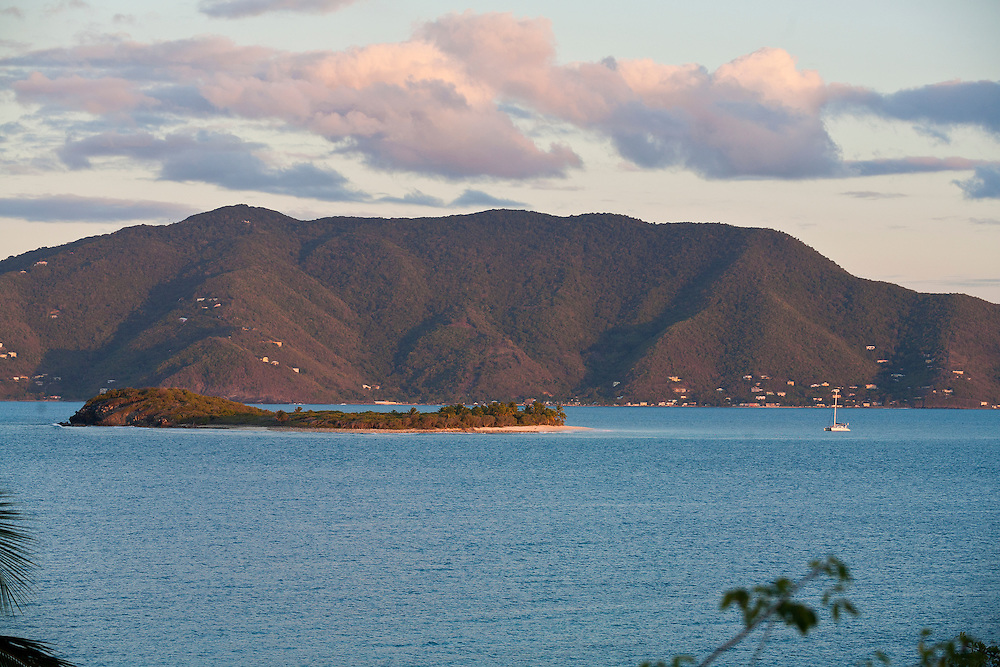 View of Tortola with Sandy Cay in foreground as seen from Jost Van Dyke at sunset