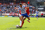 Jobi McAnuff of Reading (L) goes past Lawrie Wilson of Charlton Athletic (R) during the Sky Bet Championship match at The Valley, London<br /> Picture by Andrew Tobin/Focus Images Ltd +44 7710 761829<br /> 05/04/2014