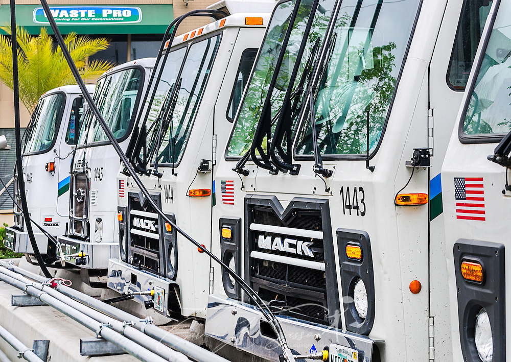 "CNG-powered (compressed natural gas) Mack trucks line up at Waste Pro's time-fill station, March 19, 2016, in Jacksonville, Florida. Waste Pro offers waste and recycling services to more than two million residential customers and more than 40,000 businesses in Alabama, Florida, Georgia, South and North Carolina, Louisiana, Mississippi, and Tennessee. The company has committed to ""going green"" by implementing a number of green initiatives, including using CNG (compressed natural gas) in its trucks, recycling more waste instead of sending it to landfills, and powering its regional headquarters throuh solar energy. (Photo by Carmen K. Sisson/Cloudybright)"