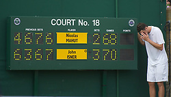24.06.2010, Wimbledon, GBR, ATP World Tour, Grand Slam, Wimbledon, Men's singles, John Isner (USA) vs Nicolas Mahut (FRA), im Bild John Isner (USA) poses next to the scoreboard after the historic longert game ever that lasted 11 hours and five minutes over three days. He beat Nicolas Mahut with the final score of 6-4 3-6 6-7 (7-9) 7-6 (7-3) 70-68 on day four. EXPA Pictures © 2010, PhotoCredit: EXPA/ Propaganda/ D. Rawcliffe / SPORTIDA PHOTO AGENCY