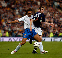 Photo: Jed Wee.<br />Scotland v Italy. FIFA World Cup Qualifying match. <br />03/09/2005.<br /><br />Italy's Andrea Pirlo (L) beats Scotland's Craig Beattie to the ball.