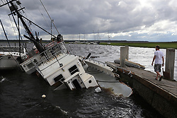 Dozens of boats are blown into the marsh and a shrimp boat sits on the bottom as local resident Michael Whitemore, 36, checks to see if a friend's boat survived at Langs Marina after Hurricane Irma hit the town on Monday, September 11, 2017, in St. Marys, GA, USA. Photo by Curtis Compton/Atlanta Journal-Constitution/TNS/ABACAPRESS.COM