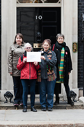 © Licensed to London News Pictures. 18/05/2013. London, UK. Save Our Hospitals campaigners hand in a letter at No 10 Downing Street in protest against the Government's changes to the Health Service and planned closures to services across London.   In the picture - Anna Hardwick representing Charing Coss Save Our Hospitals (left), Sarah Cox  representing North West London Save Our Hospitals (red jacket), Eve Acorn representing Ealing Save Our Hospitals (second from right), and Gillian Lewis (right - Inter Faith Coordinator of the Save Lewisham Hospital campaign. Backed by Unite the Union, the Save Lewisham Hospital Campaign and MPs including Andy Slaughter and Steve Pound. Photo credit : Richard Isaac/LNP