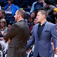 11 November 2017: Orlando Magic Assistant Coach Chad Forcier talks to Orlando Magic head coach Frank Vogel during the Denver Nuggets 125-107 victory over the Orlando Magic, at the Pepsi Center, Denver, Colorado, USA.