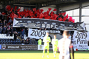 St Mirren supporters wave rows of red flags during the Ladbrokes Scottish Premiership match between St Mirren and Hibernian at the Paisley 2021 Stadium, St Mirren, Scotland on 27 January 2019.