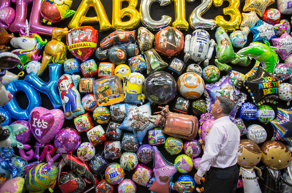 UNITED KINGDOM, London: 25 January 2016 Tony Lewis, director of Amscan (the worlds largest foil balloon manufacturer in the world, takes a look at his collection at The Toy Fair at Olympia, the UK'S only dedicated game and hobby event with more than 260 toy and gaming brands. The fair runs until tomorrow. Rick Findler / Story Picture Agency