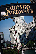The entrance to Chicago Riverwalk, looking back towards Michigan Avenue with Wrigley Building in the background. The riverwalk is a pavement running along the Chicago river from Lake Shore Drive to Franklin Street.