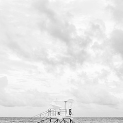 Lifeguard tower five Pensacola Beach Florida black and white photo. Pensacola Beach is on Santa Rosa Island in the Emerald Coast area of the Southeastern United States of America. Photo is vertical and high resolution. Copyright ⓒ 2018 Paul Velgos with All Rights Reserved.