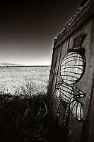 Graffiti on side of falling structure in Drawbridge/Don Edwards San Francisco Bay National Wildlife Refuge, in Alviso, CA.  Copyright 2012 Reid McNally.