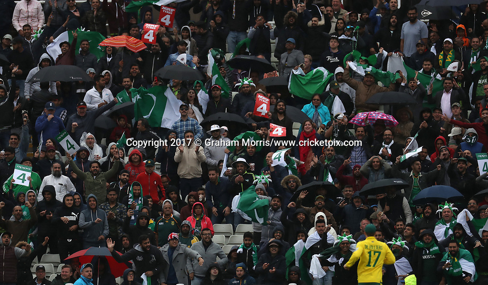 Pakistan supporters cheer a boundary as the rain starts to fall during the Champions Trophy One Day International between Pakistan and South Africa at Edgbaston, Birmingham. 7 June 2017. Photo: Graham Morris/www.cricketpix.com / www.photosport.nz