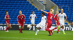 CARDIFF, WALES - Tuesday, August 21, 2014: England's Eniola Aluko scores the second goal against Wales during the FIFA Women's World Cup Canada 2015 Qualifying Group 6 match at the Cardiff City Stadium. (Pic by Ian Cook/Propaganda)