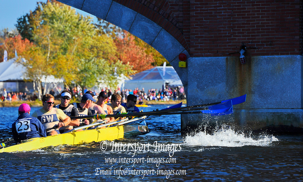 Cambridge. MA. USA. <br /> Championships men's Eights. George Washington University,  test the structure of the Eliot Bridge during the 49th edition of the Head of the Charles.<br /> <br /> <br /> 15:13:21  Sunday  20/10/2013  <br /> <br /> [Mandatory Credit. Karon PHILLIPS /Intersport Images]<br /> <br /> Orientation: Landscape<br /> <br /> Sunrise, Sunsets, Silhouettes Landscape