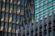 Office workers seen through the windows of their financial corporate headquarters in the heart of the Square Mile, the capital's historical and financial centre, on 1st November 2017, in the City of London, England.