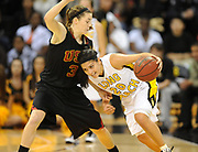 Dec 3, 2009; Long Beach, CA, USA; Long Beach State 49ers guard Karina Figueroa (20) is defended by Southern California Trojans guard Hailey Dunham (3) at the Walter Pyramid. USC defeated Long Beach State 83-77.