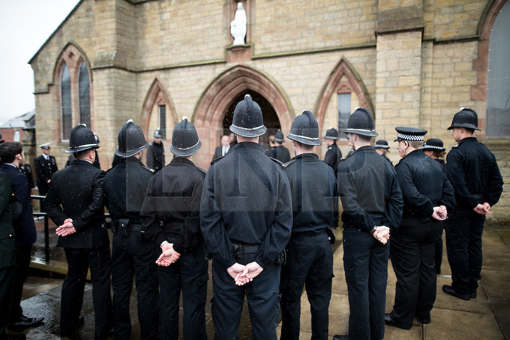 © Licensed to London News Pictures . 15/07/2016 . Bolton , UK . Police officers gather outside the church for the service .  The funeral of Special Constable Samantha Derbyshire at St Mary's RC Church in Horwich , Bolton. Derbyshire was struck and killed by an HGV on the M61 motorway following a collision , in the early hours of Monday 11th July 2016 . Photo credit : Joel Goodman/LNP