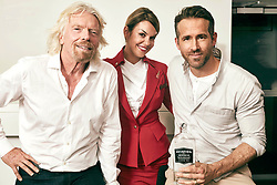 EDITORIAL USE ONLY<br /> Richard Branson, Ryan Reynolds and Flight Service Manager Vicky Lewis announce a new partnership between Virgin Atlantic and Aviation American Gin, which is owned by the actor.