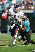 JACKSONVILLE, FL - DECEMBER 12:  Quarterback Chad Hutchinson #9 of the Chicago Bears runs from the defense in vain, as defensive tackle John Henderson #98 and the rest of his Jacksonville Jaguars teammates recorded five quarterback sacks on December 12, 2004 at Alltel Stadium in Jacksonville, Florida. The Jags defeated the Bears 22-3. ©Paul Anthony Spinelli *** Local Caption *** Chad Hutchinson;John Henderson