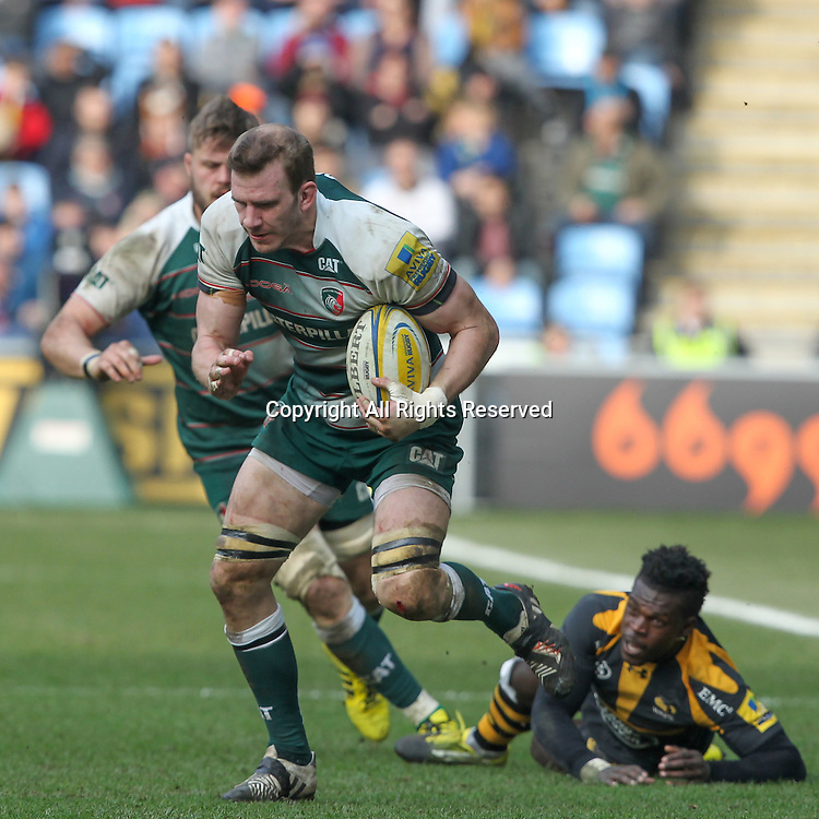 12.03.2016. Ricoh Arena, Coventry, England. Aviva Premiership. Wasps versus Leicester Tigers.  Tigers Tom Croft makes a break leaving Wasps winger Christian Wade grasping at thin air from the floor