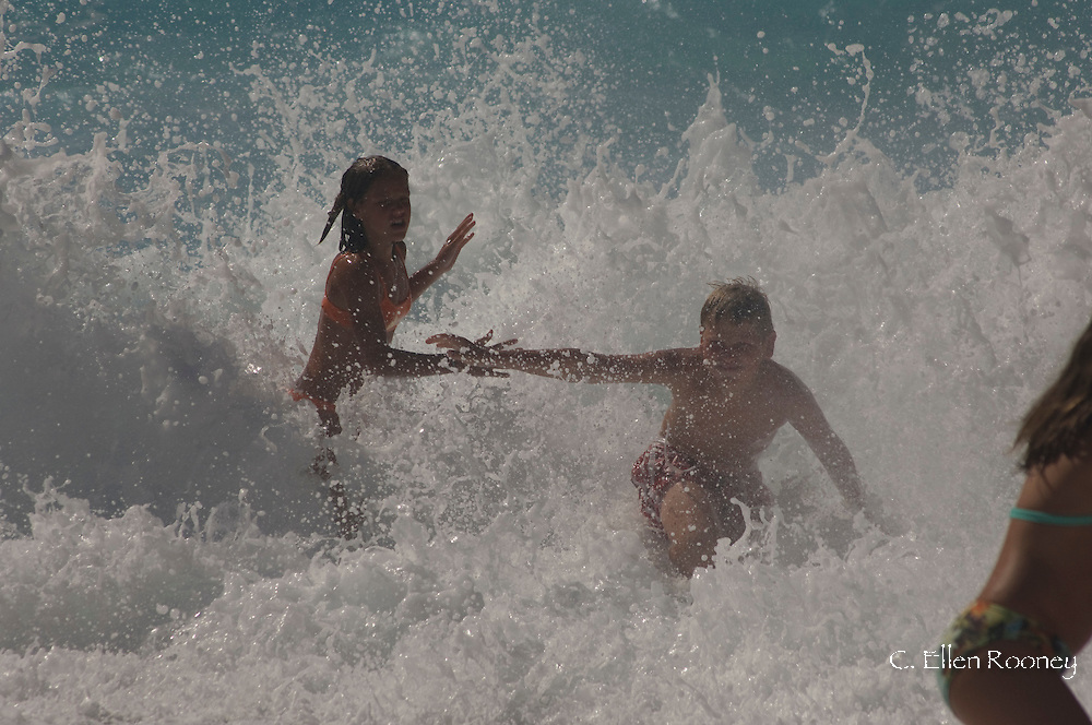 Kids playing in the surf at Myrtos Beach, Kefalonia, The Ionian Islands, Greece