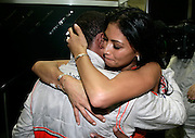 New Formula One World Champion Lewis Hamilton of Great Britain and McLaren Mercedes celebrates with his girlfriend, Pussycat Doll singer Nicole Scherzinger, following the Brazilian Formula One Grand Prix at the Interlagos Circuit on November 2, 2008 in Sao Paulo, Brazil.