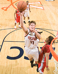Virginia forward Laurynas Mikalauskas (11) shoots a jump shot over Bradley center Sam Singh (54).  The Virginia Cavaliers fell to the Bradley Braves 96-85 in the semifinals of the 2008 College Basketball Invitational at the University of Virginia's John Paul Jones Arena in Charlottesville, VA on March 26, 2008.