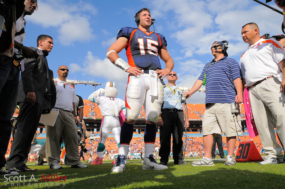 Denver Broncos quarterback Tim Tebow (15) is interviewed following the Broncos 18-15 overtime win against the Miami Dolphins at Sun Life Stadium on Oct. 22, 2011 in Miami Gardens, Fla.  ...©2011 Scott A. Miller