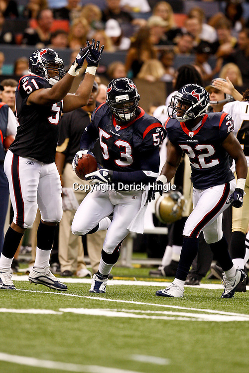 August 21, 2010; New Orleans, LA, USA; Houston Texans linebacker Danny Clark (53) celebrates after an interception during the second half of a 38-20 win by the New Orleans Saints over the Houston Texans during a preseason game at the Louisiana Superdome. Mandatory Credit: Derick E. Hingle