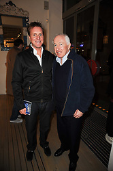 Left to right, HENRY BECKWITH and his father SIR JOHN BECKWITH at reception to raise funds for a Ugandan School Project supported by the Henry van Straubenzee Memorial Fund held at Few & Far, 242 Brompton Road, London SW3 on 11th February 2010.