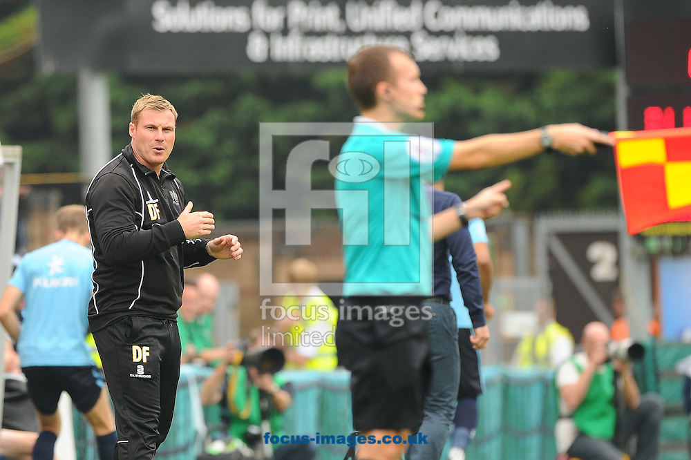 David Flitcroft of Bury questions the linesman decision during the Sky Bet League 2 match at Adams Park, High Wycombe<br /> Picture by Seb Daly/Focus Images Ltd +447738 614630<br /> 06/09/2014