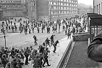 British soldiers clash with rioters in Rossville Street in the Bogside district of Londonderry, N Ireland, UK. Sporadic rioting still occured after the arrival of the British Army. September 1969. 1969090045.<br /> <br /> Copyright Image from Victor Patterson, 54 Dorchester Park, Belfast, UK, BT9 6RJ<br /> <br /> t1: +44 28 9066 1296 (from Rep of Ireland 048 9066 1296)<br /> t2: +44 28 9002 2446 (from Rep of Ireland 048 9002 2446)<br /> m: +44 7802 353836<br /> <br /> victorpattersonbelfast@gmail.com<br /> victorpatterson@me.com<br /> <br /> www.victorpatterson.com<br /> <br /> Please see my Terms and Conditions of Use at https://www.victorpatterson.com/page2<br /> It is IMPORTANT that you familiarise yourself with them.<br /> <br /> Images used on the Internet incur an additional cost and must be visibly watermarked i.e. © Victor Patterson within the body of the image and copyright metadata must not be deleted. Images used on the Internet have a size restriction of 4kbs and are chargeable at rates available at victorpatterson.com.<br /> <br /> This image is available only for the use of the download recipient i.e. television station, newspaper, magazine, book publisher, etc, and must not be passed on to any third party. It is also downloaded on condition that each and every usage is notified within 7 days to victorpatterson@me.com<br /> <br /> The right of Victor Patterson (or the named photographer) to be identified as the author is asserted in accordance with The Copyright Designs And Patents Act (1988). All moral rights are asserted.