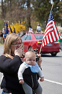Hurley, New York  - A woman and baby watch the motorcade escorting the body of  U.S. Army Sgt. Shawn M. Farrell II on Route 209 on May 7, 2014. Farrell died April 28 when forces attacked his unit with small arms fire in Afghanistan.
