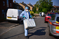 © Licensed to London News Pictures. 15/09/2016. London, UK. Police forensics at the scene of a double shooting in a block of flats in East Finchley. Police were called by London Ambulance Service at 06:25hrs this morning to reports of two people injured at an address in north London. A man and a woman were found with gunshot injuries. Both were pronounced dead at the scene. Photo credit: Ben Cawthra/LNP