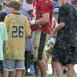 04 August 2009: New Orleans Saints quarterback Drew Brees (9) signs autographs for fans in a downpour following the end of practice during New Orleans Saints training camp at the team's practice facility in Metairie, Louisiana.