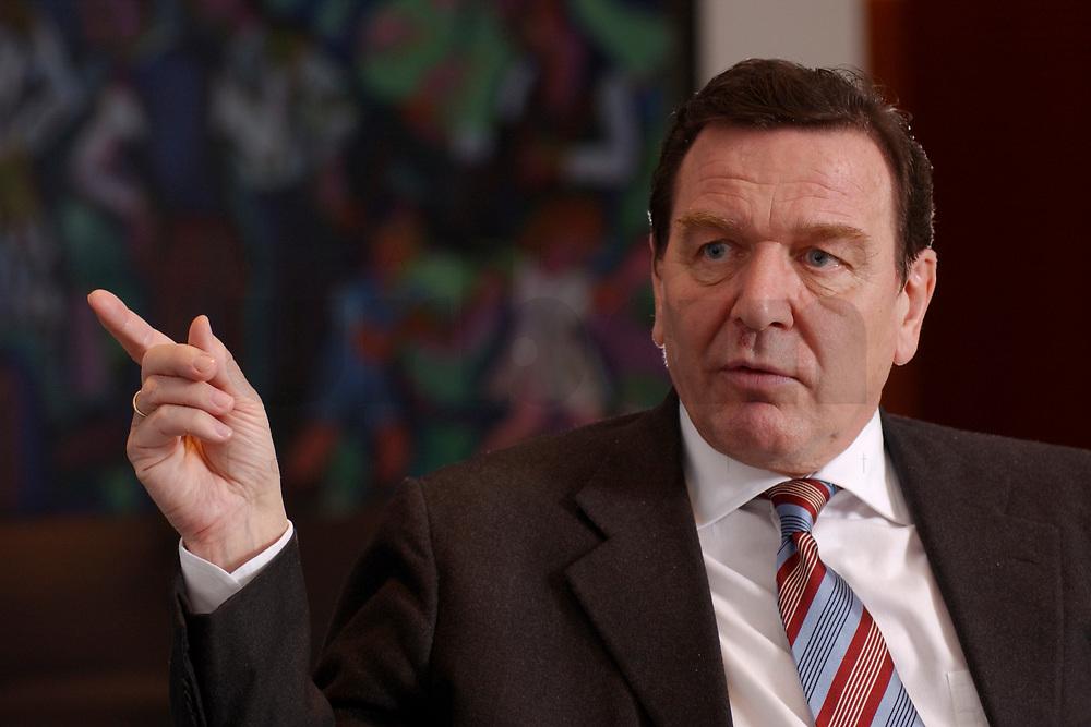 09 JAN 2002, BERLIN/GERMANY:<br /> Gerhard Schroeder, SPD, Bundeskanzler, waehrend einem Interiew, in seinem Buero, Bundeskanzleramt<br /> Gerhard Schroeder, SPD, Federal Chancellor of Germany, during an interview, in his office<br /> IMAGE: 20020109-02-005<br /> KEYWORDS: Gerhard Schröder