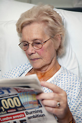 Portrait of patient reading on Cardiology Ward,