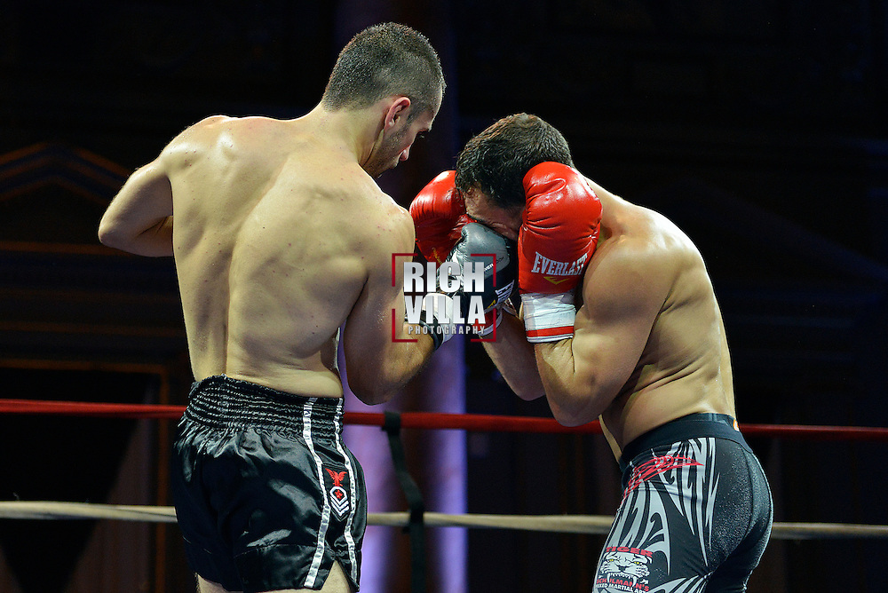 Nick Pace(Right) takes a right hand upper cut from Niko Tsigaras(Left) at Combat at the Capitale event at the Capitale Theater in New York City on September 27, 2013