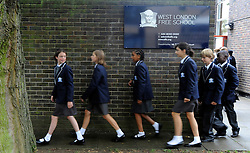 © licensed to London News Pictures. LONDON, UK.  09/09/11. Pupils walk past the school sign. London Mayor Boris Johnson joins Chair of Governors Toby Young to officially open the The West London Free School (WLFS). The WLFS is an 11-18 secondary school, which has been set up by a group of parents and teachers in Hammersmith. The school is led by headmaster Thomas Packer . Mandatory Credit Stephen Simpson/LNP
