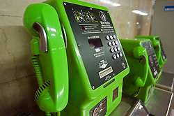 Typical green coin operated public telephones in a Tokyo subway station in Japan