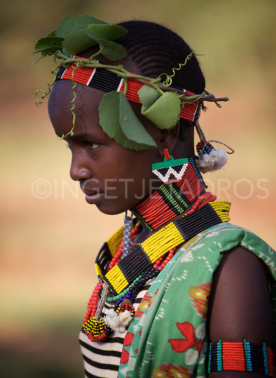 The Hamars are known for practice of body adornment and wearing a multitude of colorful beads. Exclusive at AuroraPhotos.<br />