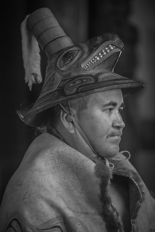 Chuck Miller wears his 300 year old moose skin robe and coho hat that has been passed down to him from uncle to nephew. Totem National Historic Park in Sitka Alaska.