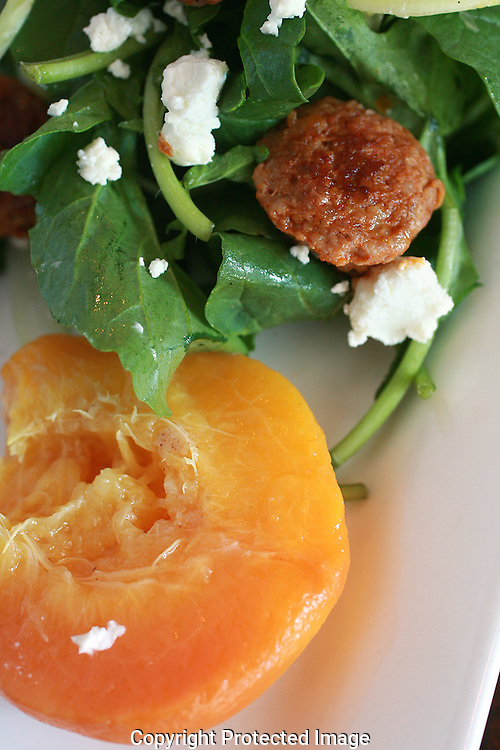Latitude 41 uses fresh peaches from the green grocer for their warm peach salad, chorizo from Blues Creek Farms and goat cheese from the Bluejacket Dairy.(Jodi Miller/Alive)