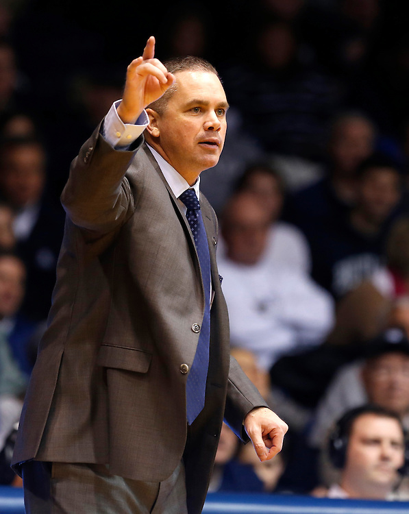 Butler head coach Chris Holtmann calls out to his team against Providence in the second half of the game at Hinkle Fieldhouse Tuesday January 6, 2015. Butler lost 66-62.