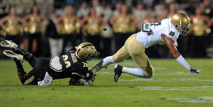 Wide receiver TJ Jones (7) is tripped up by Purdue Boilermakers cornerback Josh Johnson (28) in the first.