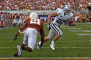 September 29, 2007 - Austin, TX..Wide receiver Jordy Nelson #27 of the Kansas State Wildcats rushes past strong safety Erick Jackson #21 of the Texas Longhorns for a first quarter touchdown, during a NCAA football game at Darrell Royal-Texas Memorial Stadium on September 29, 2007...FBC:  The Wildcats defeated the Longhorn 41-21.  .Photo by Peter G. Aiken/Cal Sport Media