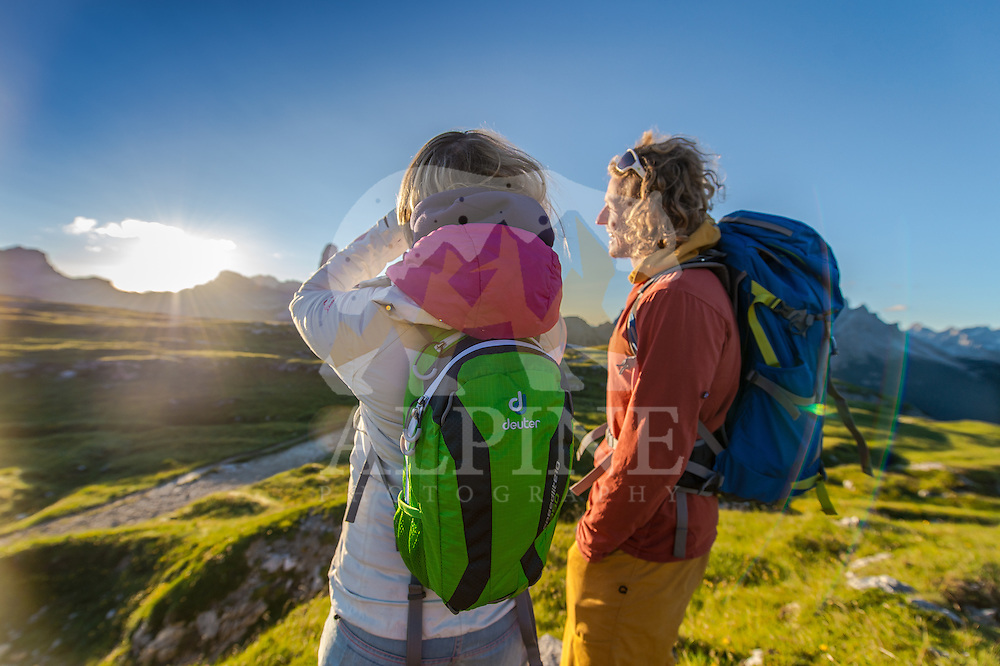 A close-up view of a couple of athletes as seen on a cold but sunny Summer morning, enjoying the warm rays of sun on Monte Piana, South Tyrol, Italy.
