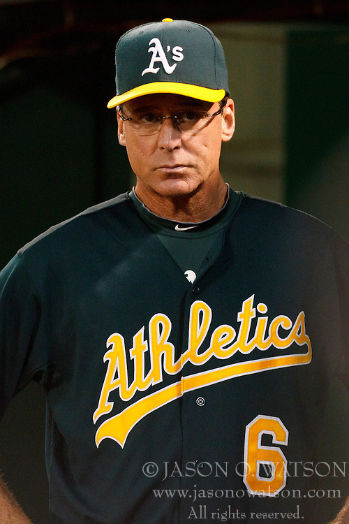September 20, 2011; Oakland, CA, USA;  Oakland Athletics manager Bob Melvin (6) stands in the dugout during the sixth inning against the Texas Rangers at O.co Coliseum.
