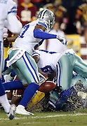 Washington Redskins wide receiver DeSean Jackson (11) lies on the bottom of a pile of defenders after fumbling a fourth quarter punt and turning the ball over to the Dallas Cowboys during the 2015 week 13 regular season NFL football game against the Dallas Cowboys on Monday, Dec. 7, 2015 in Landover, Md. The Cowboys won the game 19-16. (©Paul Anthony Spinelli)