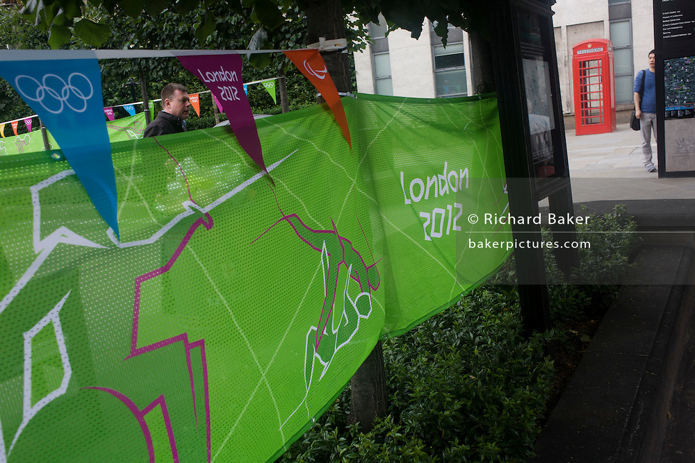 London2012 Olympic banner and pendants in the City of London's financial district promoting diverse sports.